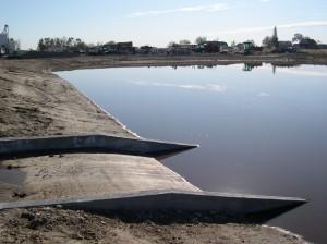 Concrete spillway into new impoundment prevents erosion